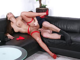 Mea Melone takes the bone while wearing sexy red fishnets