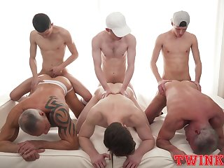 Naked men endure young twinks in their asses for a wild gay orgy