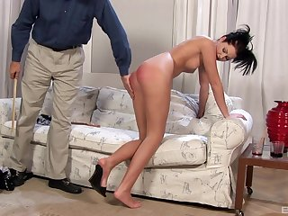Naughty brunette maid Belicia Avalos enjoys getting spanked