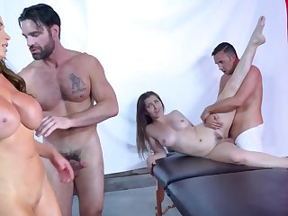 Two hot babes get rammed by their unstintingly endowed masseurs