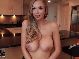 Killer, towheaded housewife with immense, rock-hard milk cans, Sophie Reade is doing some posing in the kitchen