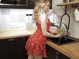 Svelte girl named Sophie climbs onto the kitchen counter encircling masturbate