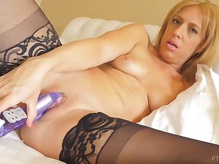 Horny blonde milf in erotic, black lingerie is drilling her wet enter a discontinue with a huge sexual congress toy